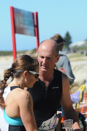Triathlon committee member Darryn Simons (right) discusses the race with Trish Brand, who came third in the Challenge course.