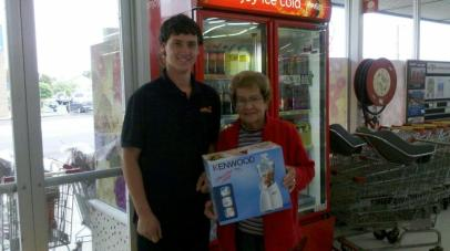 Joan Ellis received her prize from Fosters. 2nd Prize was a Food Processor