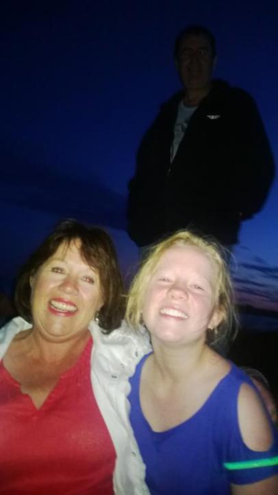 Carol Bishop of Millicent, Darcie Smith of Adelaide and Mark Braes Millicent in background enjoying a fun night at the the Beachport fireworks