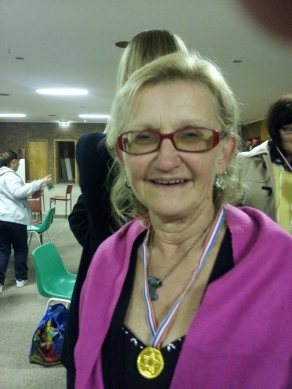 Elaine wears her medal with pride