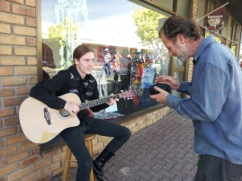Busker Jack Lane and appreciative listener