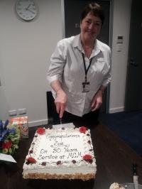 Sue cuts the cake