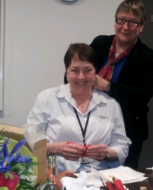 Dr Wachtel presenting Sue with her platinum and pearl necklace and ear-rings