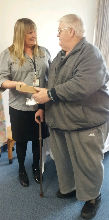 Tom Briggs presented Julie Walker with the additional battery for the Portable Respiratory Machine donated to the Medical Clinic Millicent last year