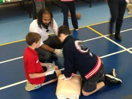 Students at Newbery Park learning CPR Skills