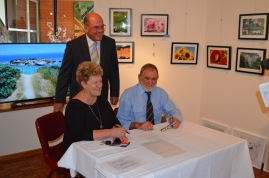 Justice of the Peace Margaret Hamilton, Mayor Gandolfi. Cr Kevin McGrath (rt) signs the oath