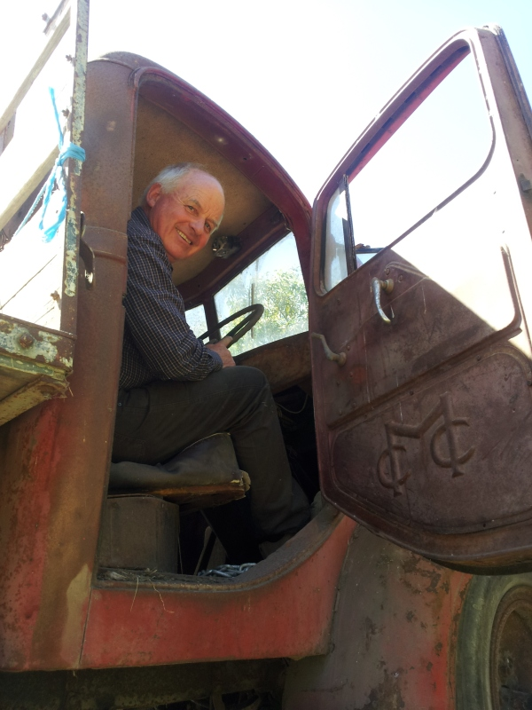 Mr Brian Foster in the driving seat of his father's truck