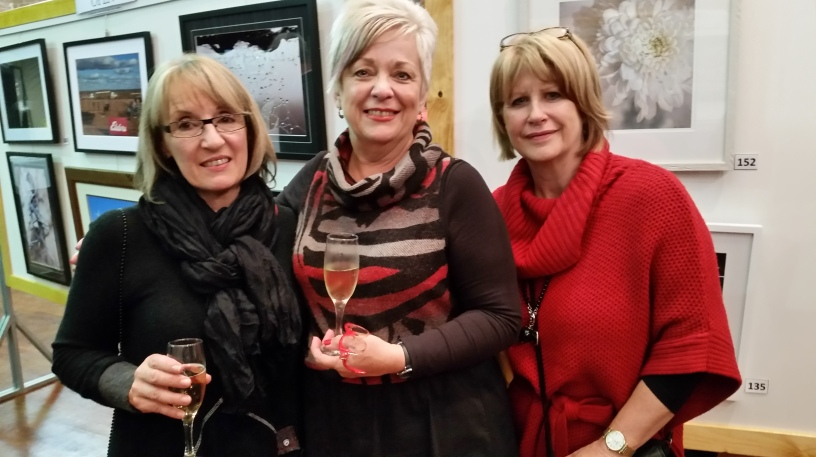 Linda Heins, Lisa Braes and Julie Eustice celebrate Linda's win