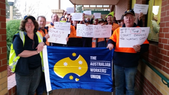 Outside council workers assemble at council